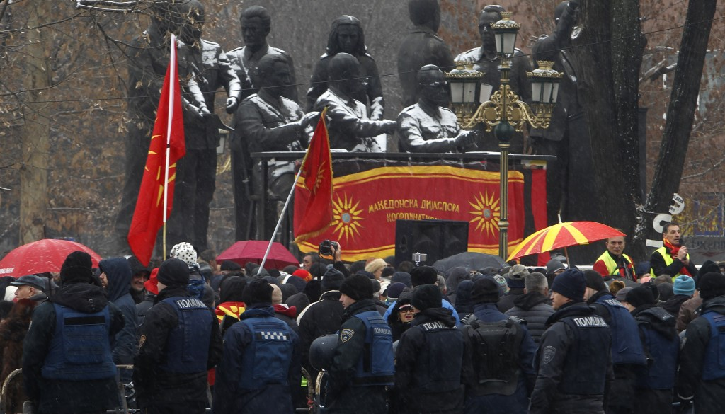 Police stand guard during a protest against the change of the country's name outside the parliament building in Skopje, Macedonia, Wednesday, Jan. 9,
