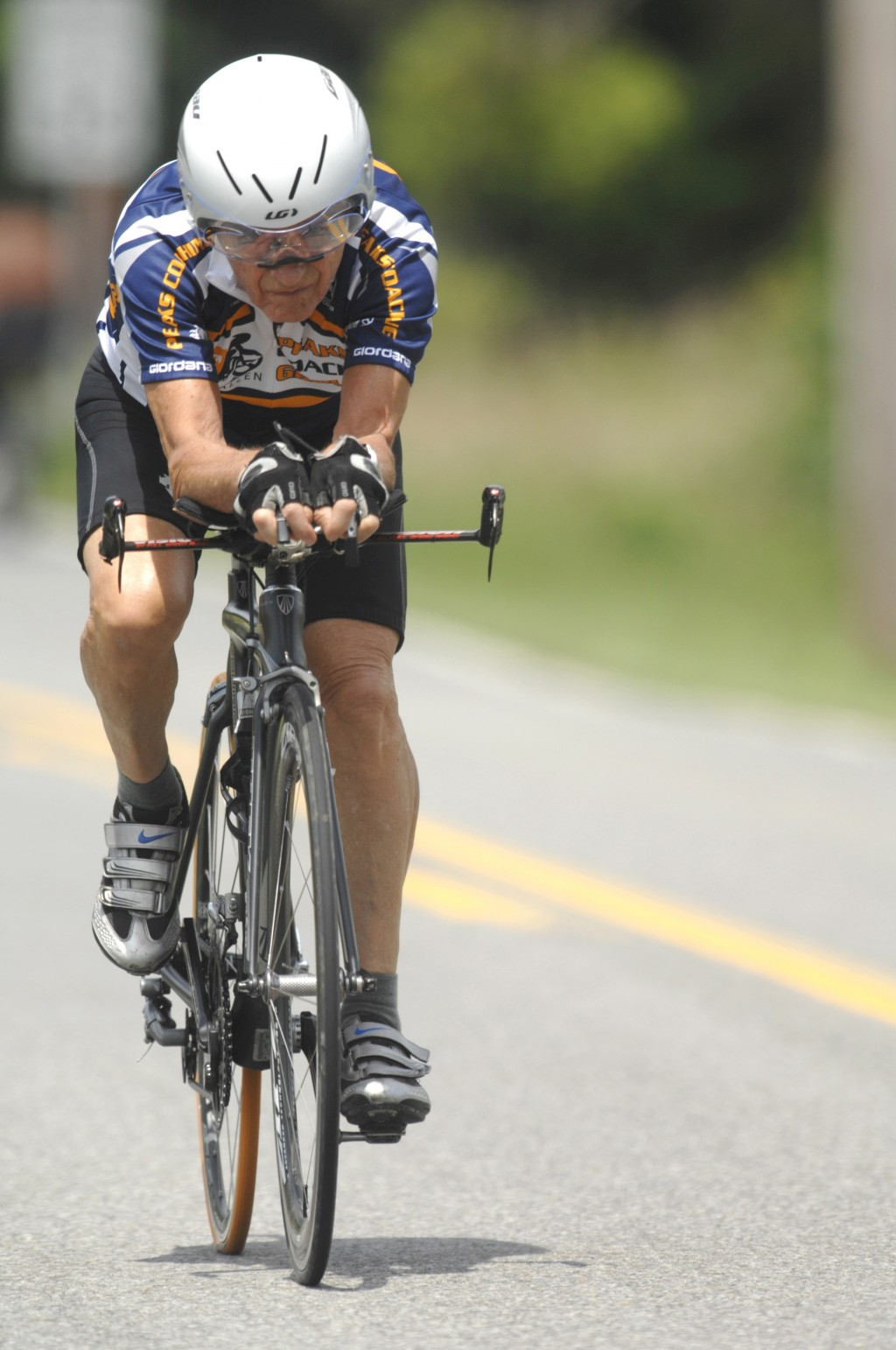 FILE - In this Tuesday, August 9, 2011 file picture, Carl Grove trains on an Elkhart County road near Bristol, In.. USA, in preparation for his return