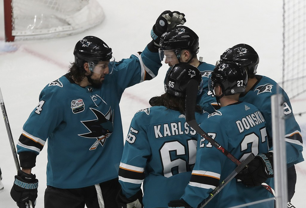 San Jose Sharks celebrate after right wing Joonas Donskoi (27), from Finland, scored a goal against the Edmonton Oilers during the third period of an