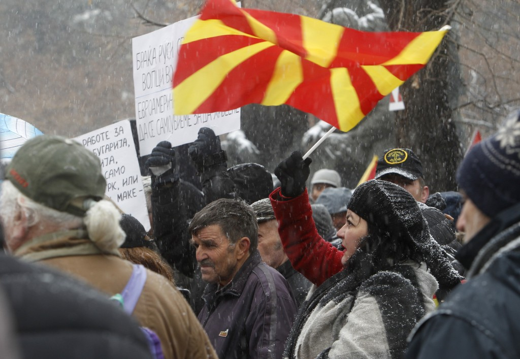 Opponents to the change of the country's constitutional name protest outside the parliament building prior to a session of the Macedonian Parliament i