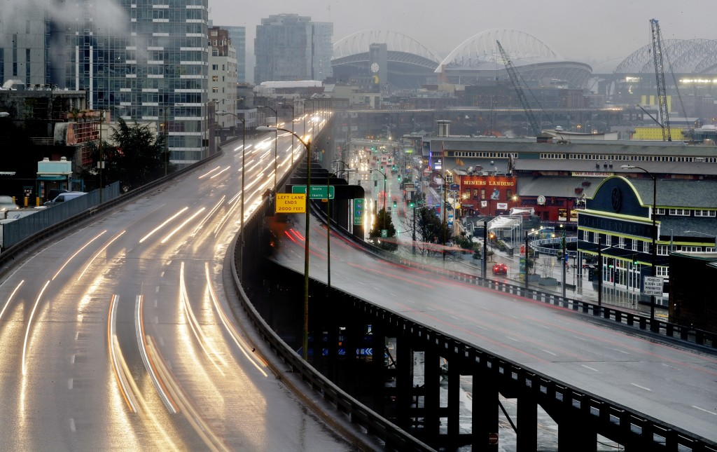 In this long-exposure photo taken Thursday, Jan. 3, 2019, headlights and taillights of Alaskan Way Viaduct traffic lines the highway ahead of an upcom