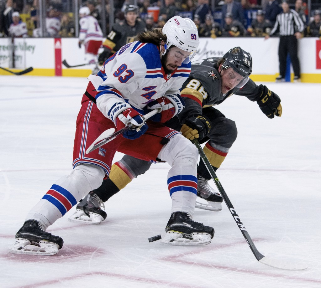 Vegas Golden Knights defenseman Nate Schmidt battles for the puck against New York Rangers center Mika Zibanejad during the first period of an NHL hoc