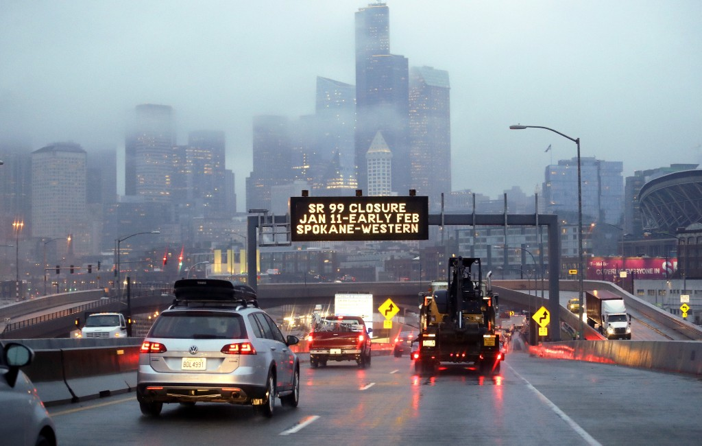 In this photo taken Thursday, Jan. 3, 2019, rush hour northbound Highway 99 traffic backs-up while heading toward the Alaskan Way Viaduct just ahead a