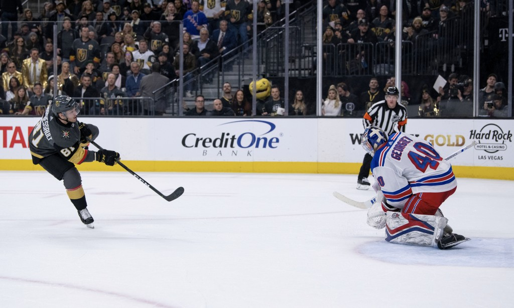Vegas Golden Knights center Jonathan Marchessault scores a goal against New York Rangers goalie Alexandar Georgiev during the second period of an NHL