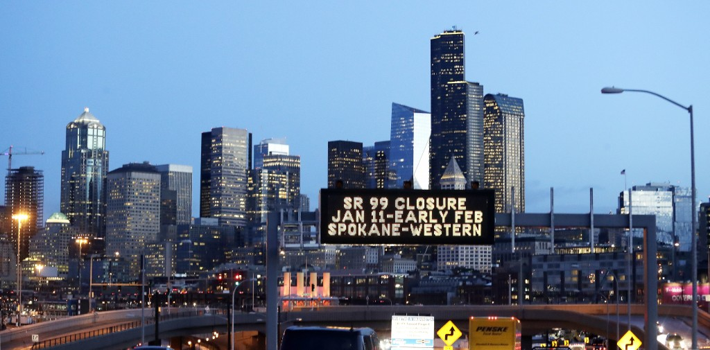 In this photo taken Friday, Jan. 4, 2019, a sign overhead advises of an upcoming closure of the the Alaskan Way Viaduct in Seattle. The double-decker