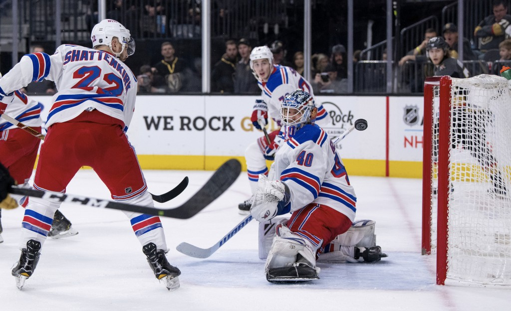 New York Rangers defenseman Kevin Shattenkirk and goalie Alexandar Georgiev watch the puck go by during the second period of the team's NHL hockey gam