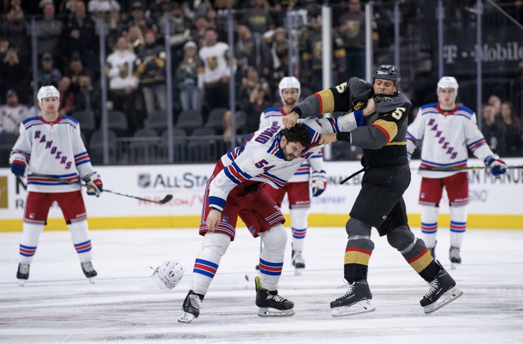 Vegas Golden Knights right wing Ryan Reaves, right front, and New York Rangers defenseman Adam McQuaid fight during the third period of an NHL hockey