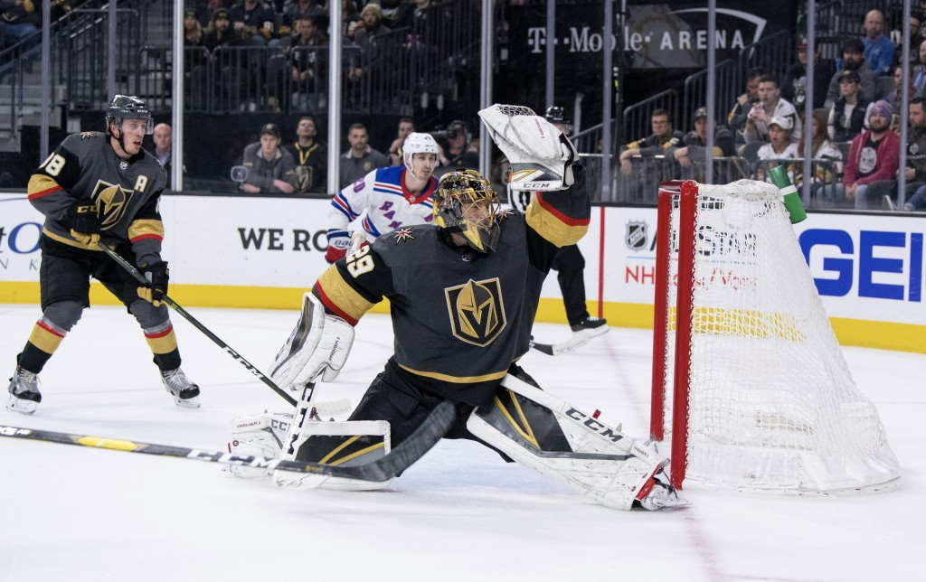 Vegas Golden Knights goalie Marc-Andre Fleury makes a save against the New York Rangers during the third period of an NHL hockey game Tuesday, Jan. 8,