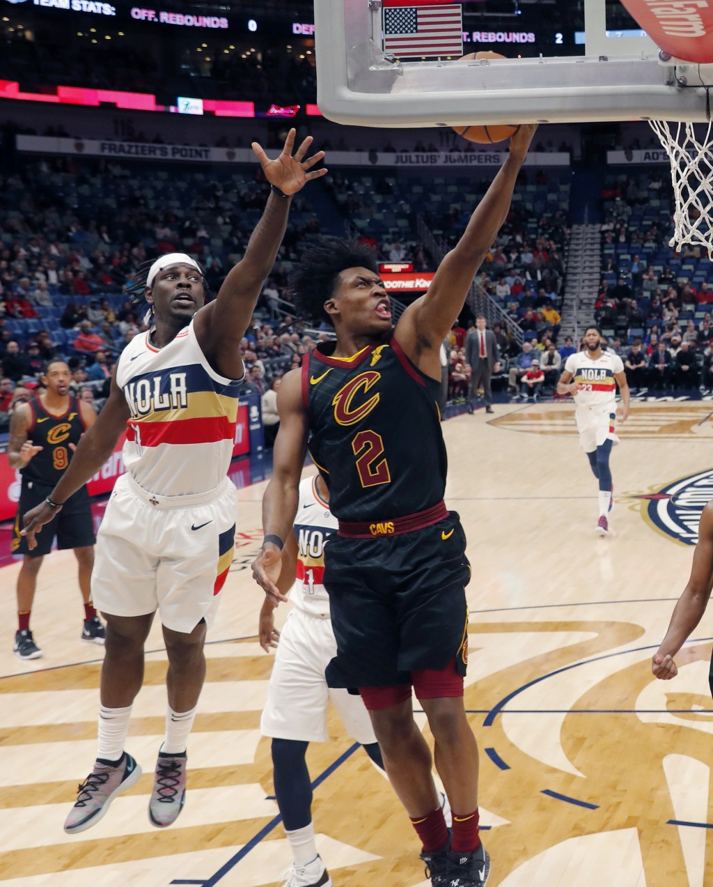 Cleveland Cavaliers guard Collin Sexton (2) goes to the basket againstNew Orleans Pelicans guard Jrue Holiday in the first half of an NBA basketball g