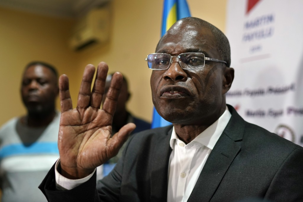 Opposition candidate Martin Fayulu speaks to the press at his headquarters in Kinshasa, Congo, Thursday Jan. 10, 2019. Fayulu, who came second in the