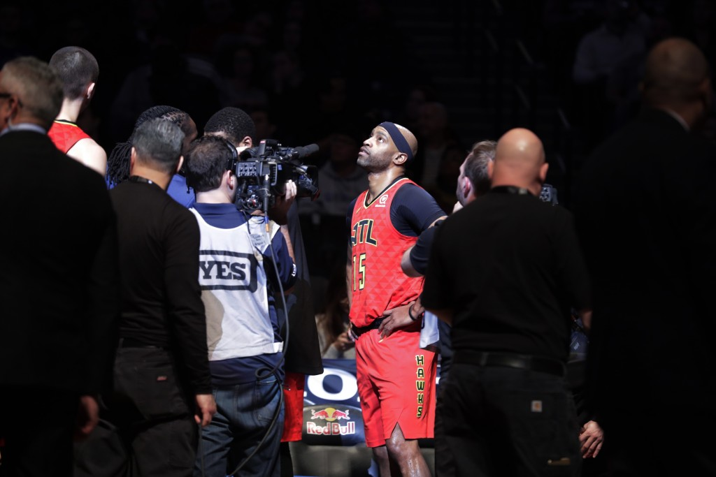 Atlanta Hawks' Vince Carter (15) watches a video tribute to him during the first half of the team's NBA basketball game against the Brooklyn Nets on W...