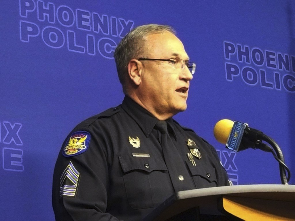 Phoenix Police spokesman Tommy Thompson speaks at a news conference, Wednesday, Jan. 9, 2019, in Phoenix, about the investigation of a woman at a long