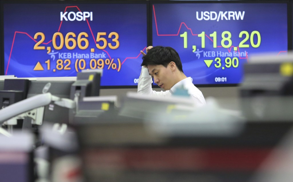 A currency trader watches monitors at the foreign exchange dealing room of the KEB Hana Bank headquarters in Seoul, South Korea, Thursday, Jan. 10, 20...