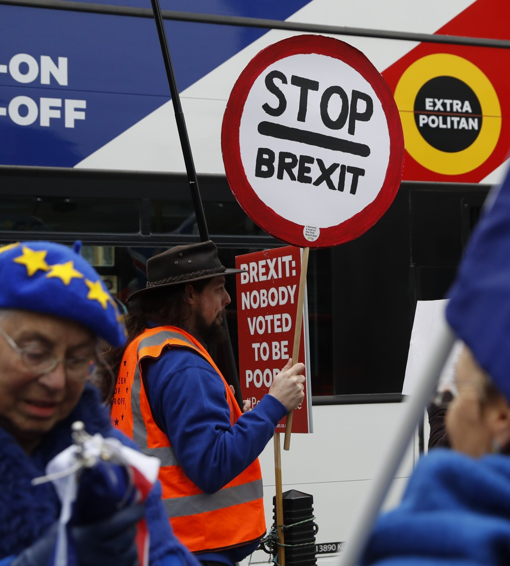 Anti-Brexit demonstrator makes his views known, outside parliament in London, Thursday Jan. 10, 2019. Prime Minister Theresa May's proposed Brexit dea