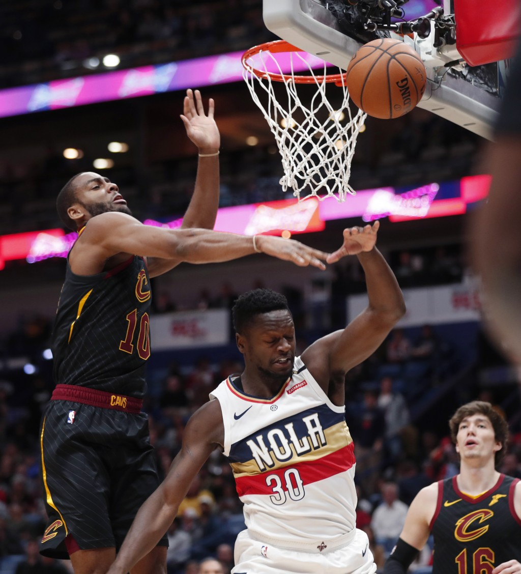 Cleveland Cavaliers guard Alec Burks (10) swats the ball after New Orleans Pelicans forward Julius Randle (30) is fouled while driving to the basket i