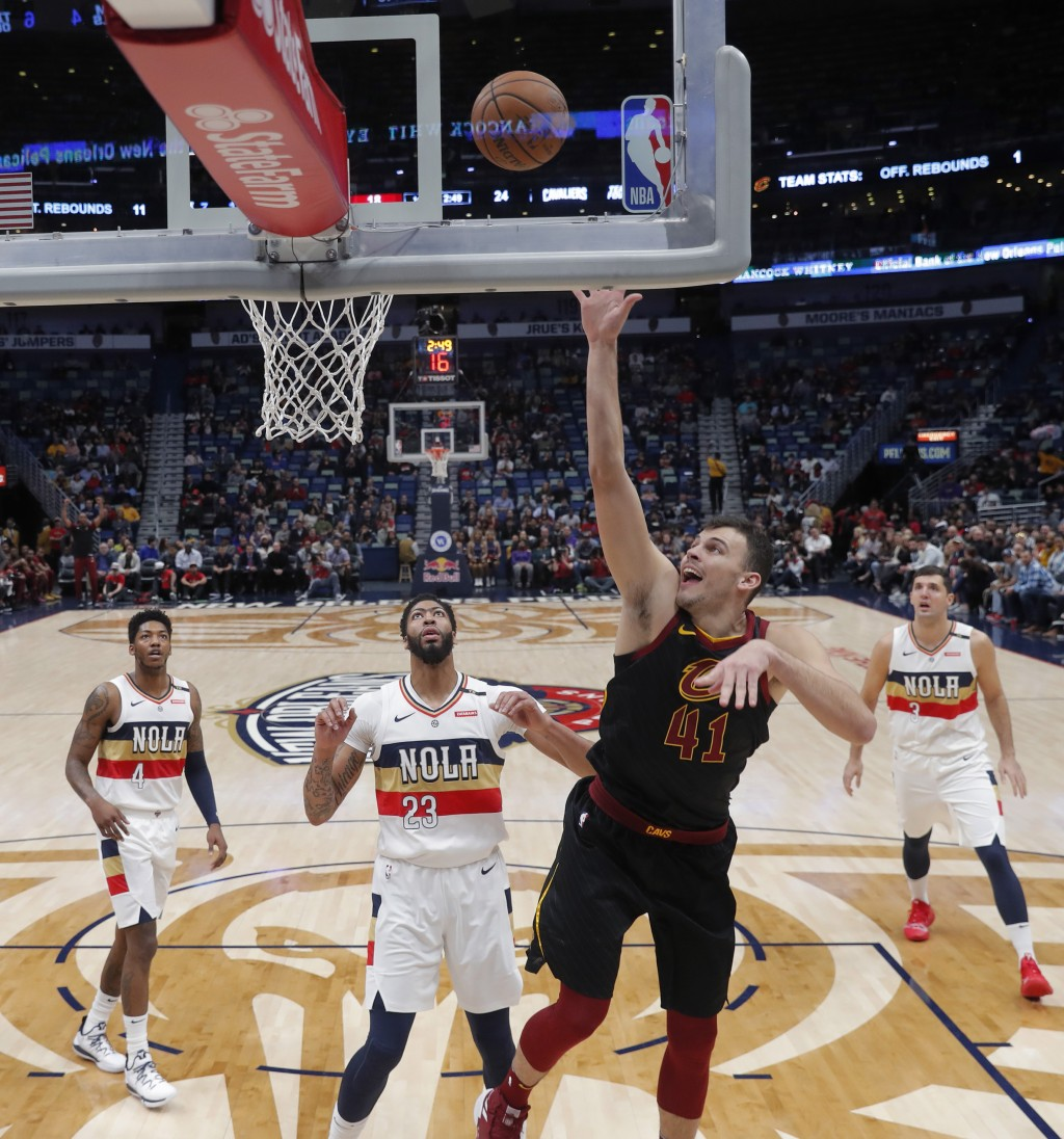 Cleveland Cavaliers center Ante Zizic (41) goes to the basket against New Orleans Pelicans forward Anthony Davis (23) in the first half of an NBA bask