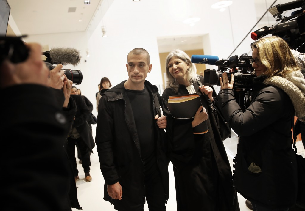 Russian performance artist Pyotr Pavlensky arrives with his lawyer Dominique Beyreuther Minkov at the Paris courthouse, Thursday, Jan. 10, 2019. Pavle
