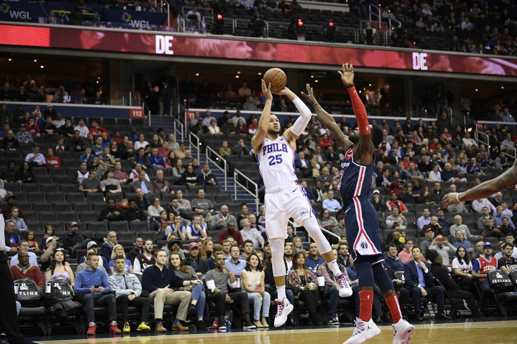 Philadelphia 76ers guard Ben Simmons (25) shoots against Washington Wizards forward Jeff Green, right, during the first half of an NBA basketball game...