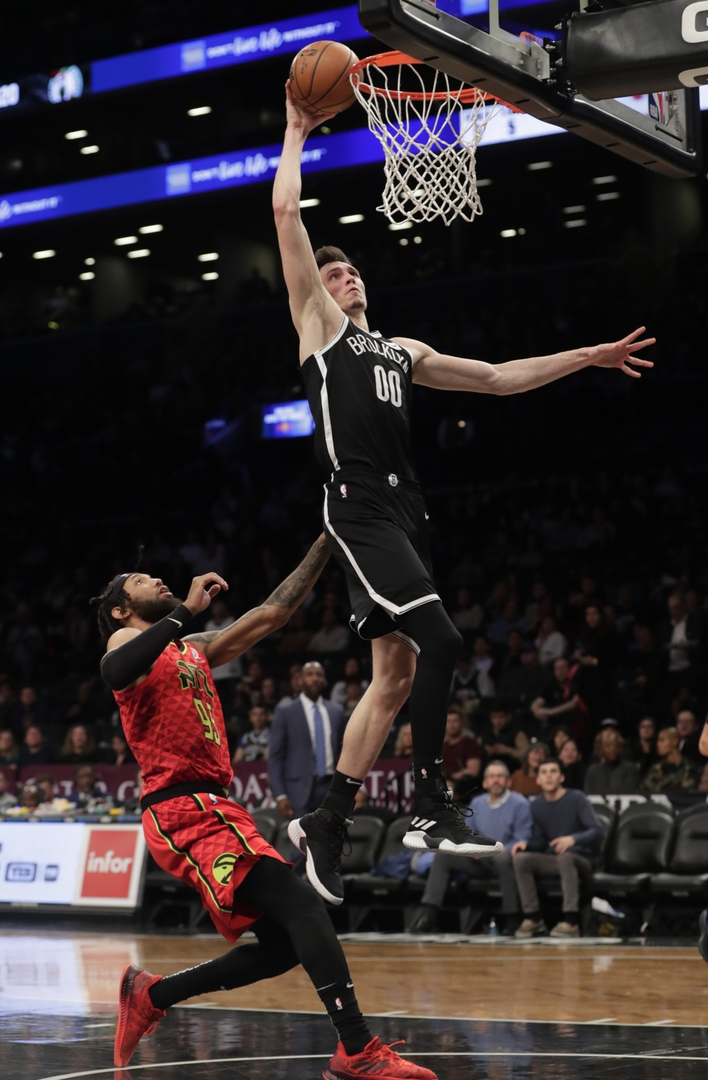Brooklyn Nets' Rodions Kurucs (00) dunks in front of Atlanta Hawks' DeAndre' Bembry (95) during the second half of an NBA basketball game Wednesday, J