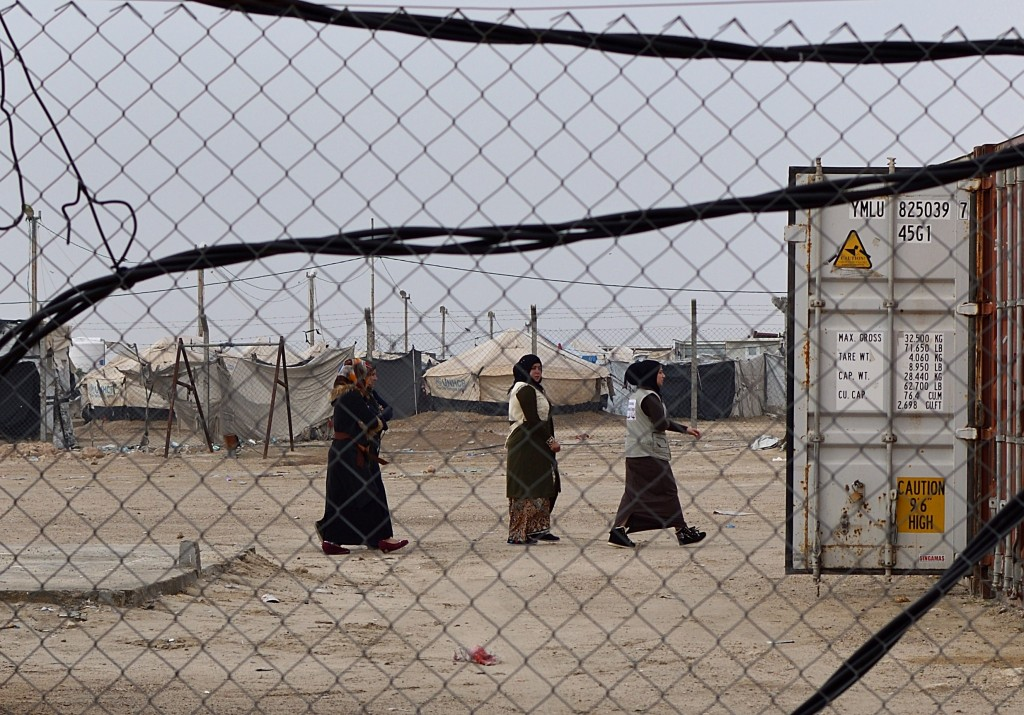 This Dec. 26, 2018 photo, shows displaced women in Bzeibiz camp, Anbar province, Iraq. A little over a year since the country fought its last battle a