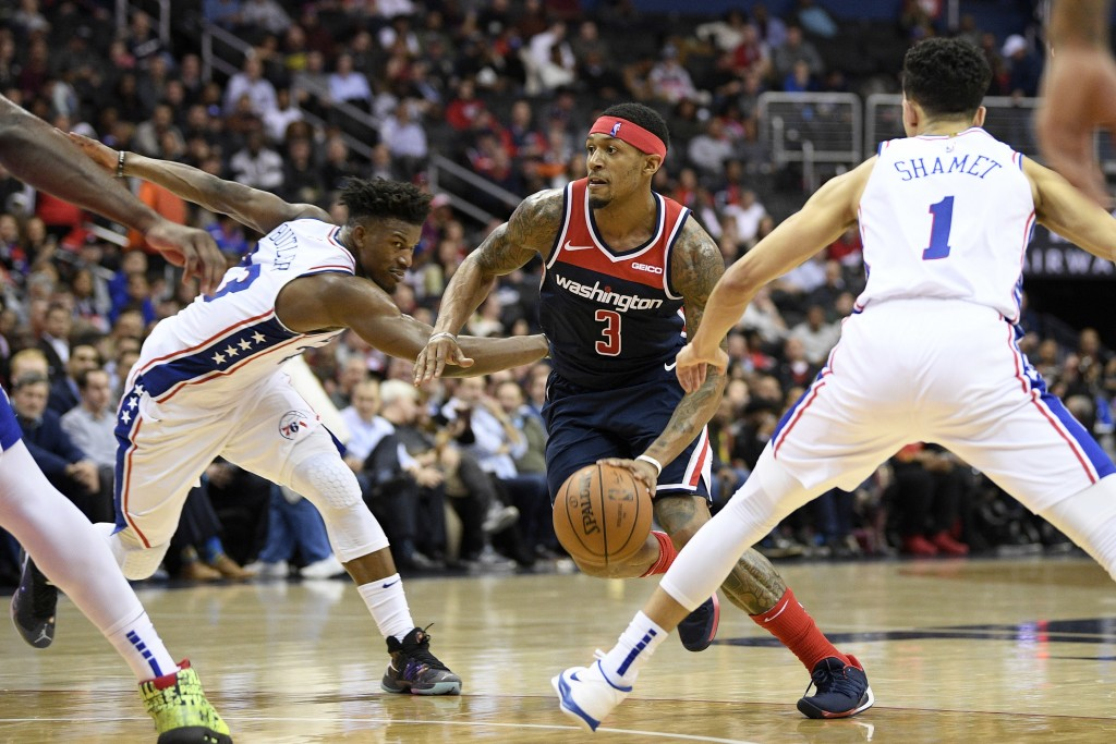 Washington Wizards guard Bradley Beal (3) dribbles the ball between Philadelphia 76ers guard Landry Shamet (1) and guard Jimmy Butler (23) during the ...