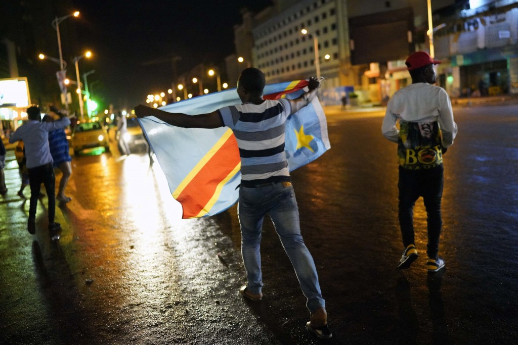 Residents celebrate in Kinshasa, Congo, Thursday Jan. 10, 2019, after learning that opposition presidential candidate Felix Tshisekedi had been declar