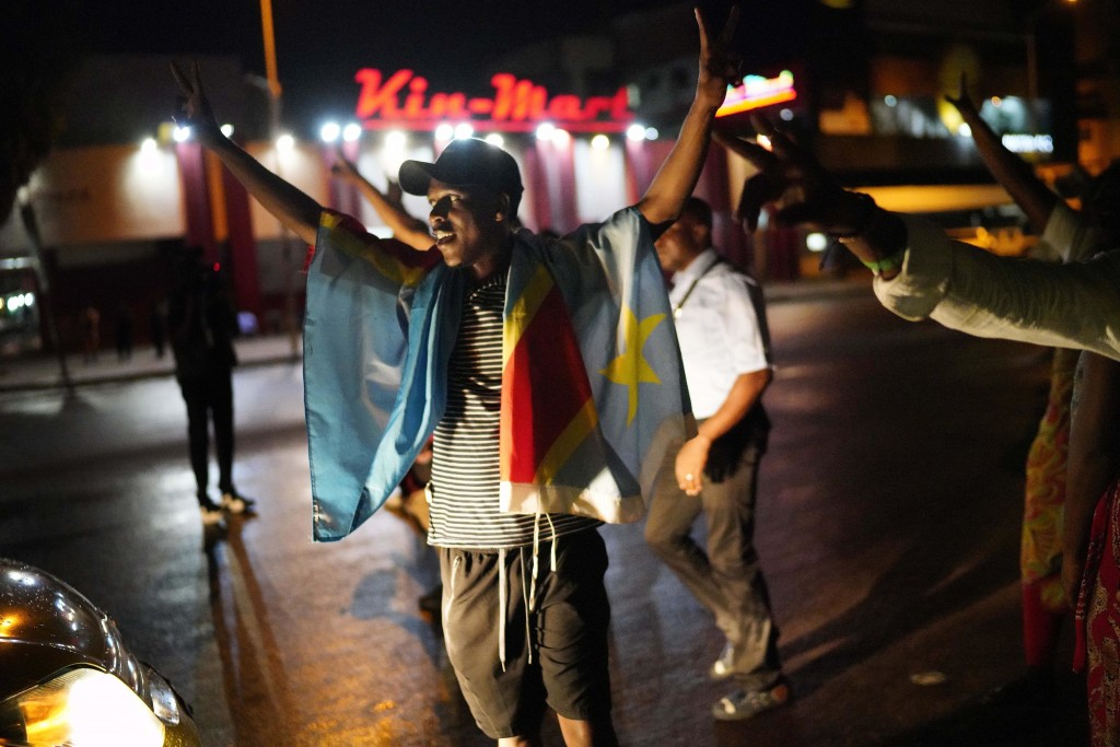 Kinshasa residents celebrate in Kinshasa Thursday Jan. 10, 2019, after learning that opposition presidential candidate Felix Tshisekedi had been decla