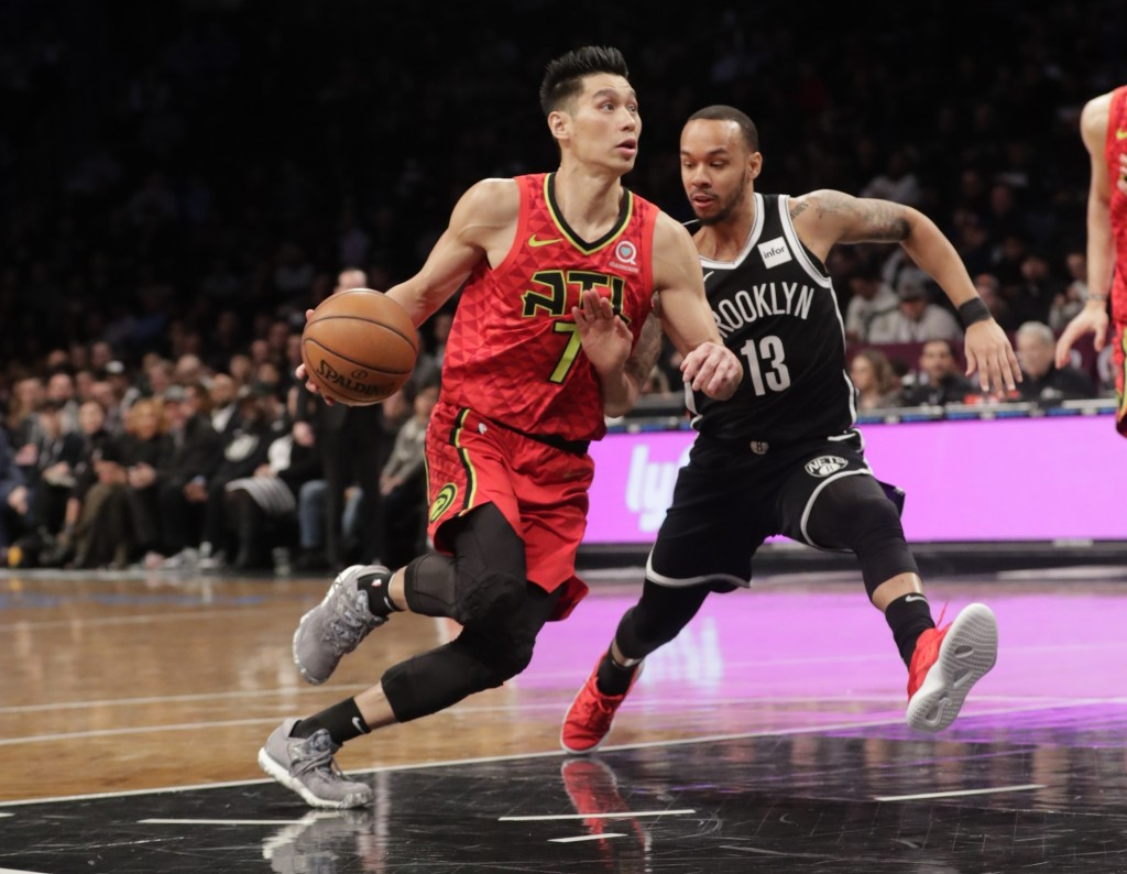 Atlanta Hawks' Jeremy Lin (7) drives past Brooklyn Nets' Shabazz Napier (13) during the first half of an NBA basketball game Wednesday, Jan. 9, 2019, ...