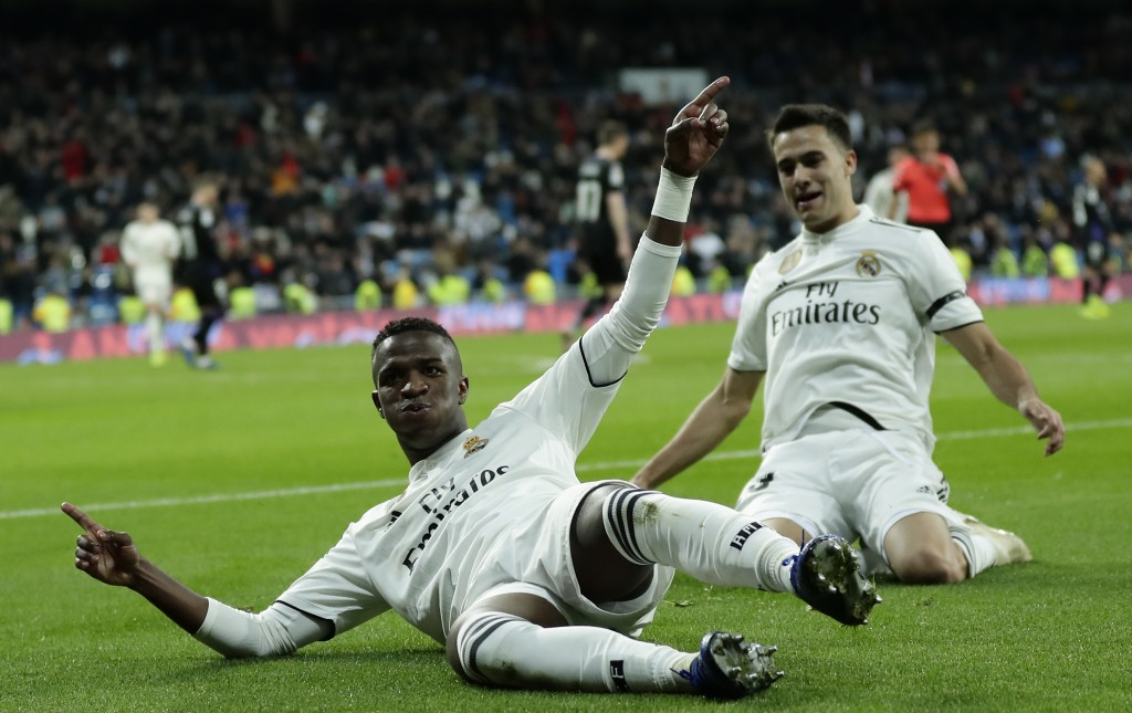 Real Madrid's Vinicius Jr, left, celebrates after scoring during a Spanish Copa del Rey soccer match between Real Madrid and Leganes at the Bernabeu s