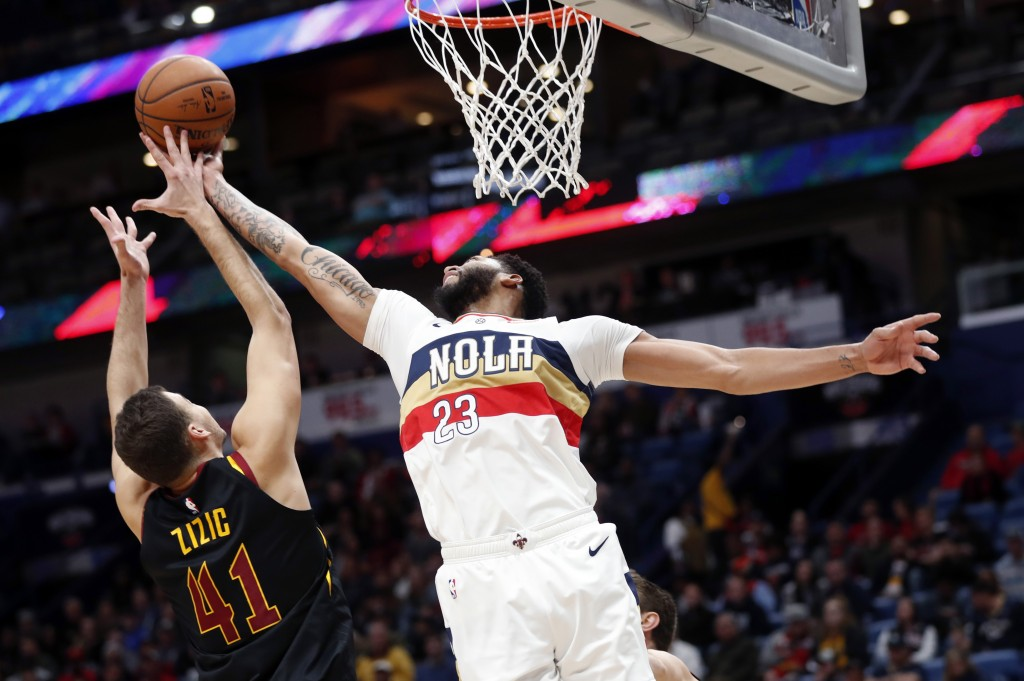 New Orleans Pelicans guard Ian Clark (2)3 battles under the basket against Cleveland Cavaliers center Ante Zizic (41) in the first half of an NBA bask