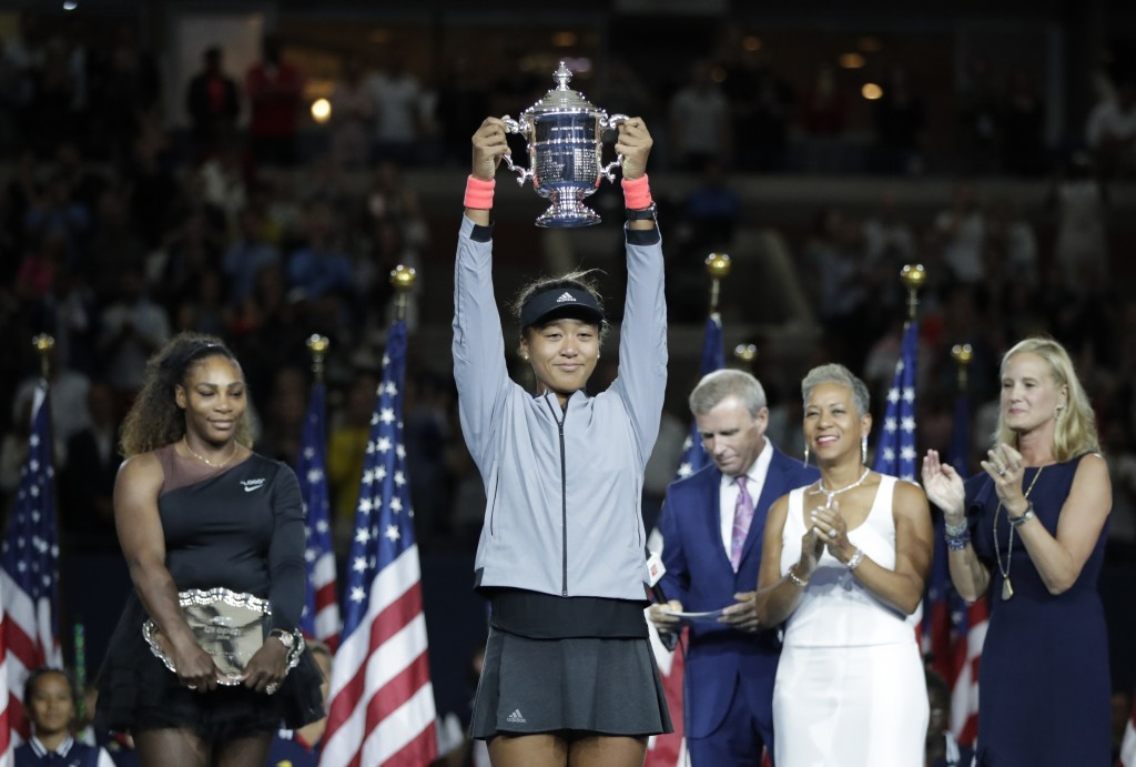 FILE - In this Sept. 8, 2018, file photo, Naomi Osaka, of Japan, holds the trophy after defeating Serena Williams in the women's final of the U.S. Ope