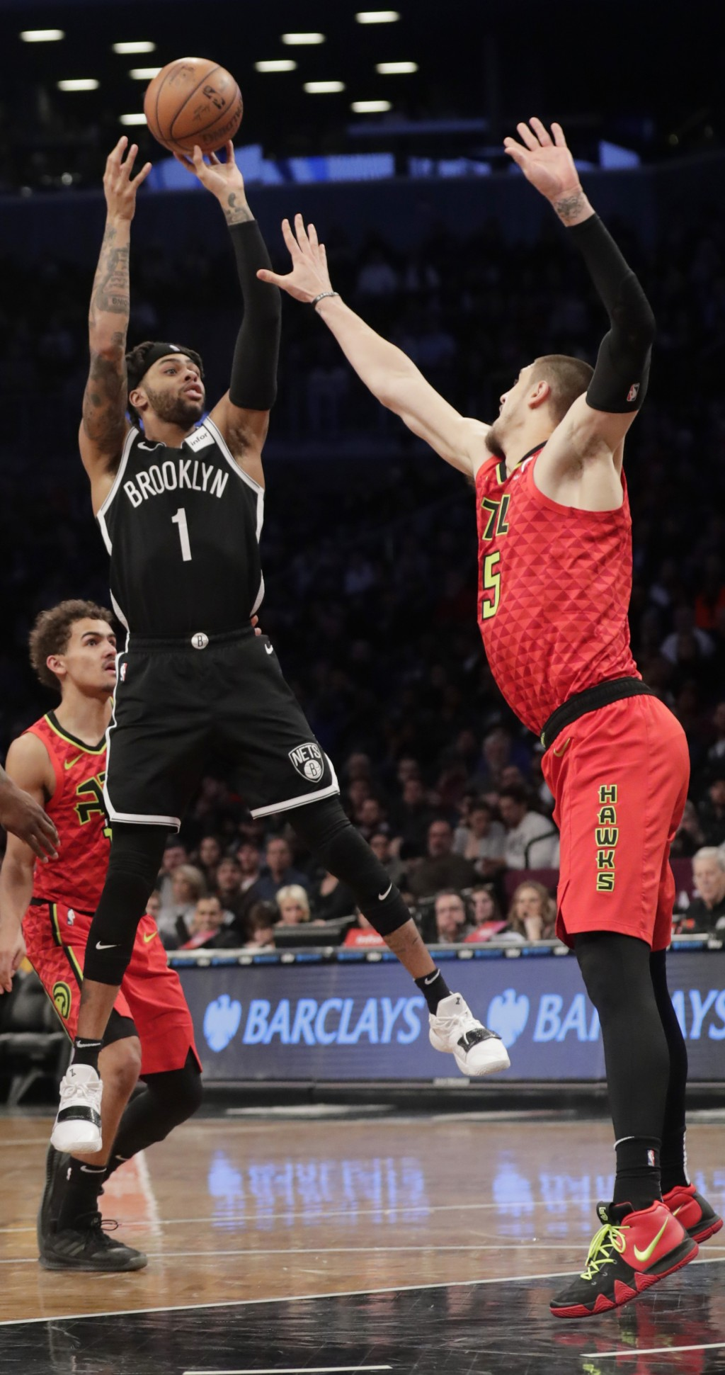 Brooklyn Nets' D'Angelo Russell (1) shoots over Atlanta Hawks' Alex Len (25) during the second half of an NBA basketball game Wednesday, Jan. 9, 2019,...