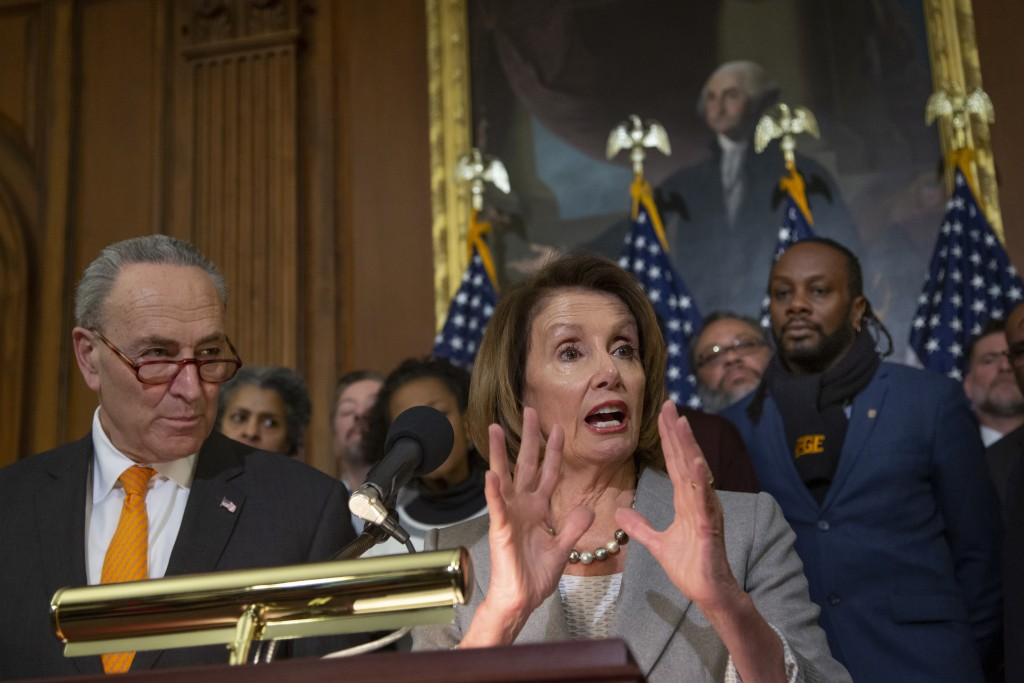Speaker of the House Nancy Pelosi, D-Calif., and Senate Minority Leader Chuck Schumer, D-N.Y., left, are joined by furloughed federal workers at an ev