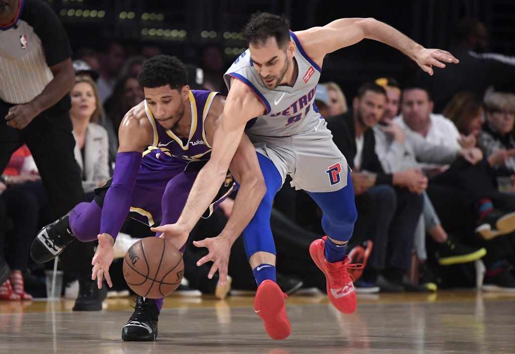 Los Angeles Lakers guard Josh Hart, left, and Detroit Pistons guard Jose Calderon go after a loose ball during the first half of an NBA basketball gam...