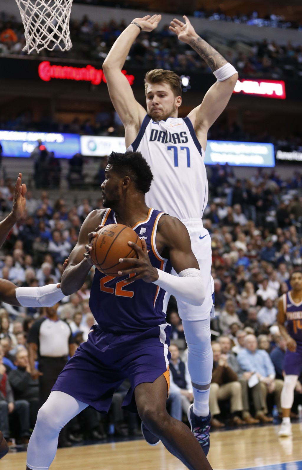 Phoenix Suns center Deandre Ayton (22) looks to shoot as Dallas Mavericks forward Luka Doncic (77) guards during the first half of an NBA basketball g...
