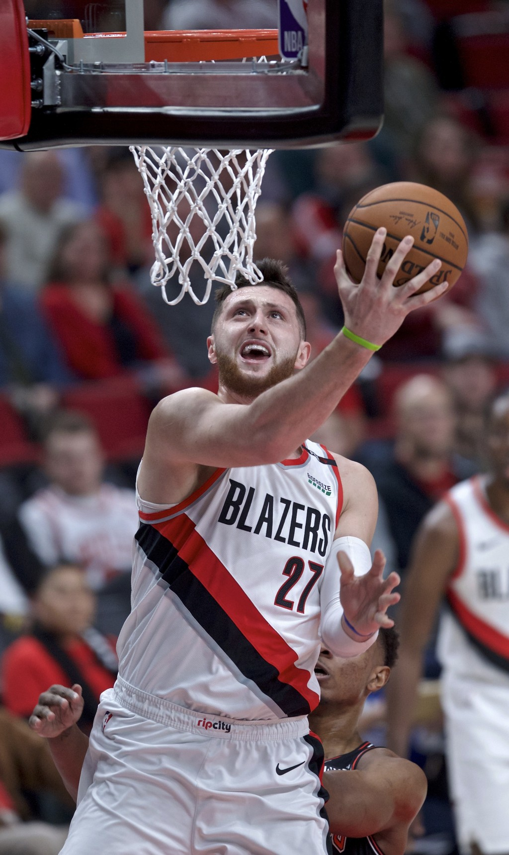 Portland Trail Blazers center Jusuf Nurkic scores during the first half of the team's NBA basketball game against the Chicago Bulls in Portland, Ore.,