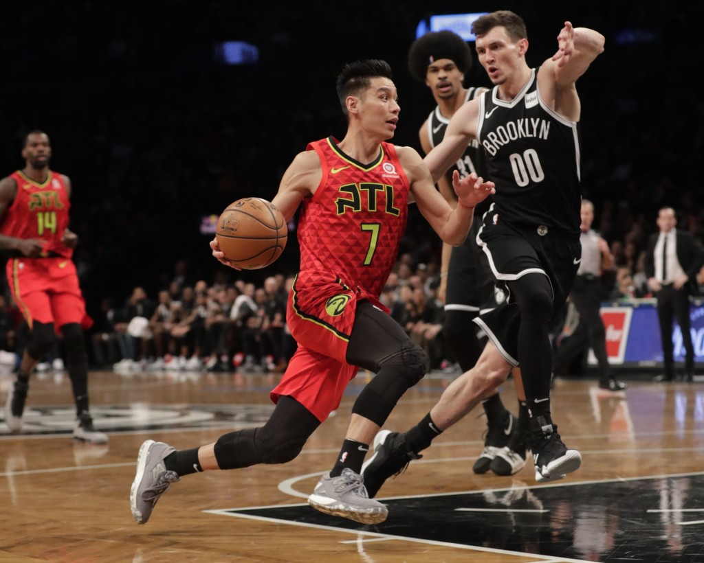 Brooklyn Nets' Rodions Kurucs (00) defends against Atlanta Hawks' Jeremy Lin (7) during the first half of an NBA basketball game Wednesday, Jan. 9, 20...