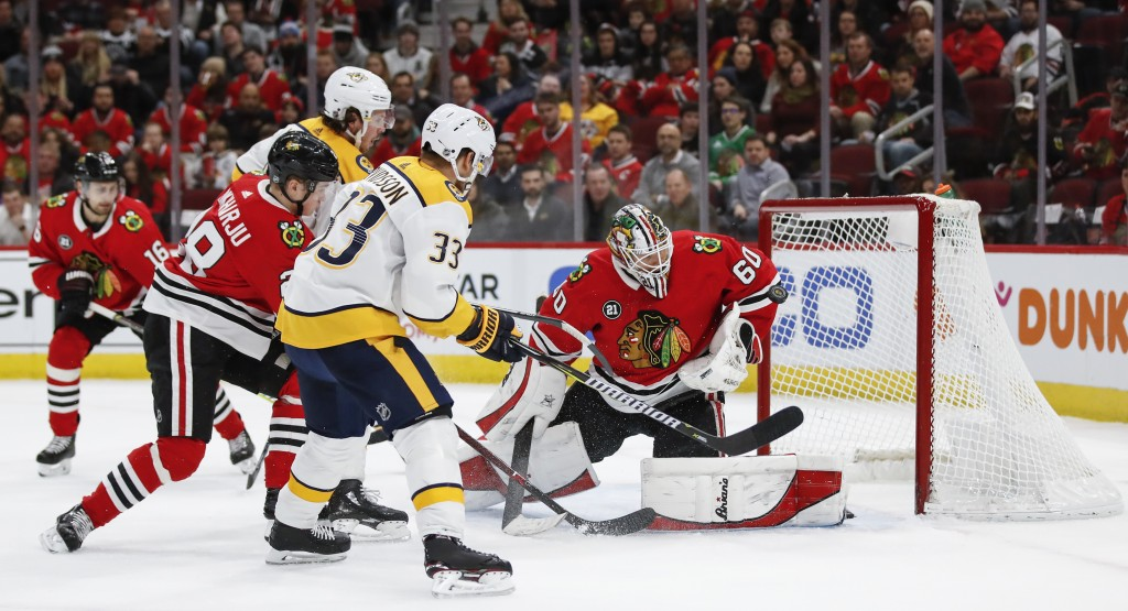 Chicago Blackhawks goaltender Collin Delia (60) defends against Nashville Predators right wing Viktor Arvidsson (33) during the first period of an NHL...