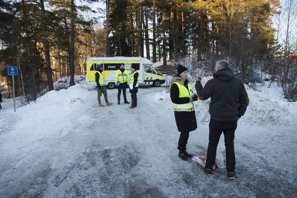 Police patrol outside the home of Norwegian billionaire Tom Hagen and his wife Anne-Elisabeth Falkevik Hagen in Fjellhamar, Norway, Thursday, Jan. 10,