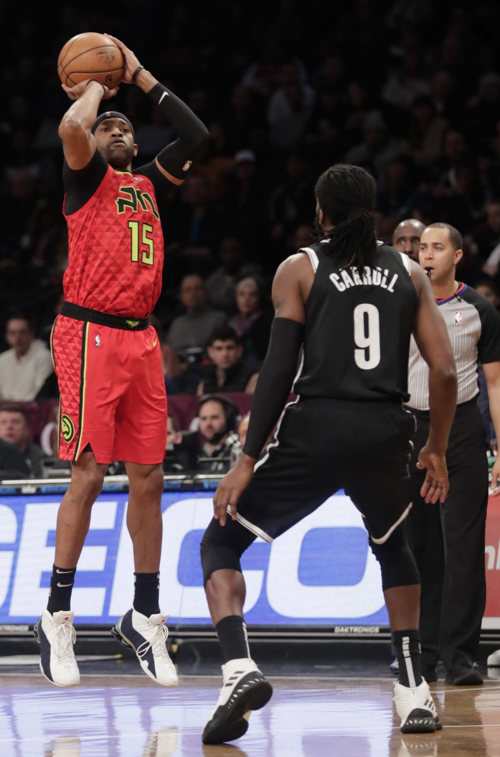 Atlanta Hawks' Vince Carter (15) shoots over Brooklyn Nets' DeMarre Carroll (9) during the first half of an NBA basketball game Wednesday, Jan. 9, 201