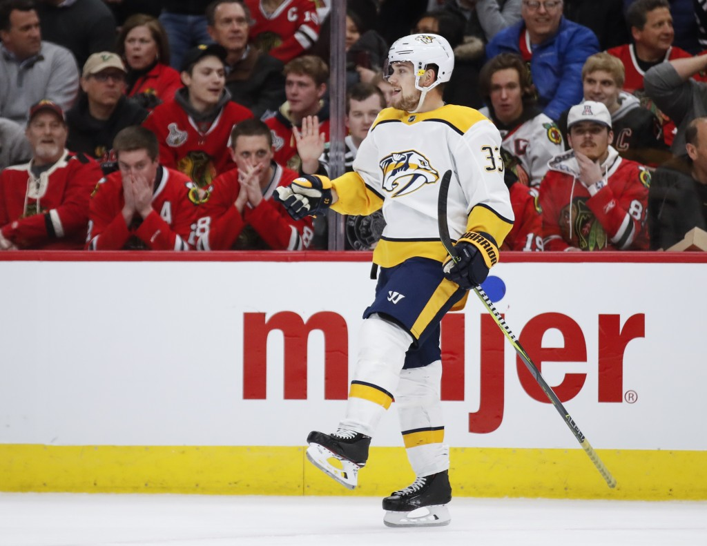 Nashville Predators right wing Viktor Arvidsson celebrates after scoring against the Chicago Blackhawks during the first period of an NHL hockey game