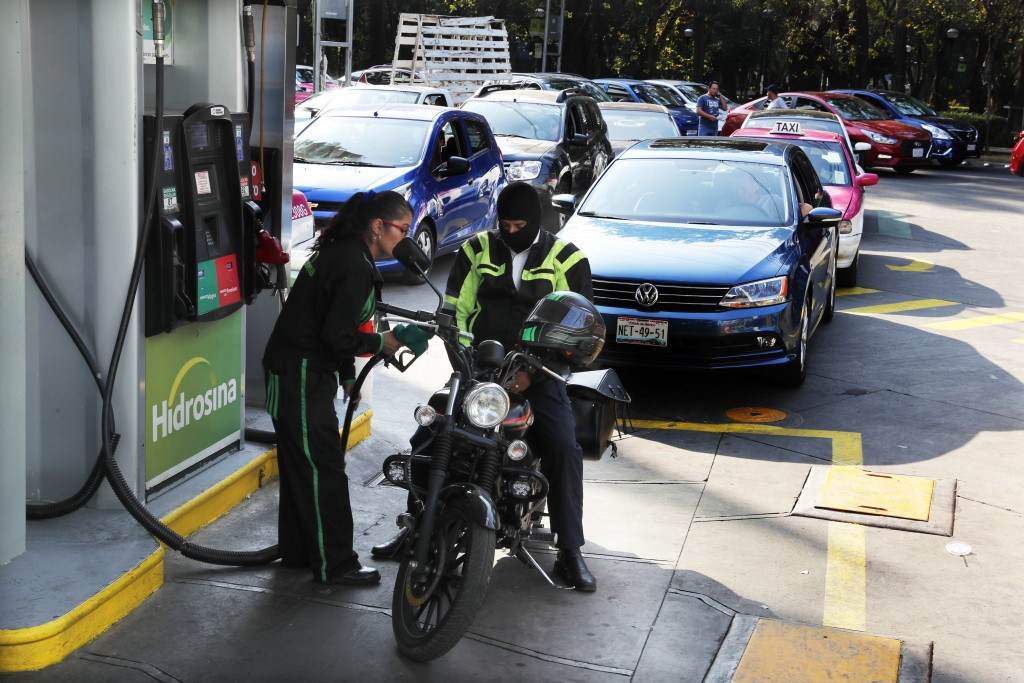 Vehicles stand in line to fill up their fuel tanks at a gas station in Mexico, City, Wednesday, Jan. 9, 2019. A fuel scarcity arose after President An