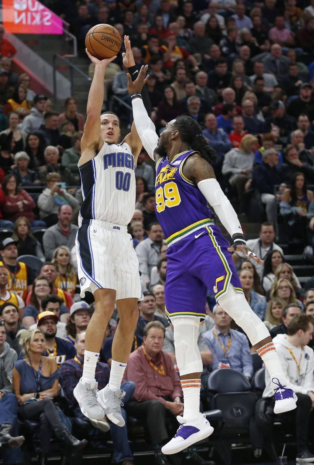 Orlando Magic forward Aaron Gordon (00) shoots as Utah Jazz forward Jae Crowder (99) defends during the first half of an NBA basketball game Wednesday...