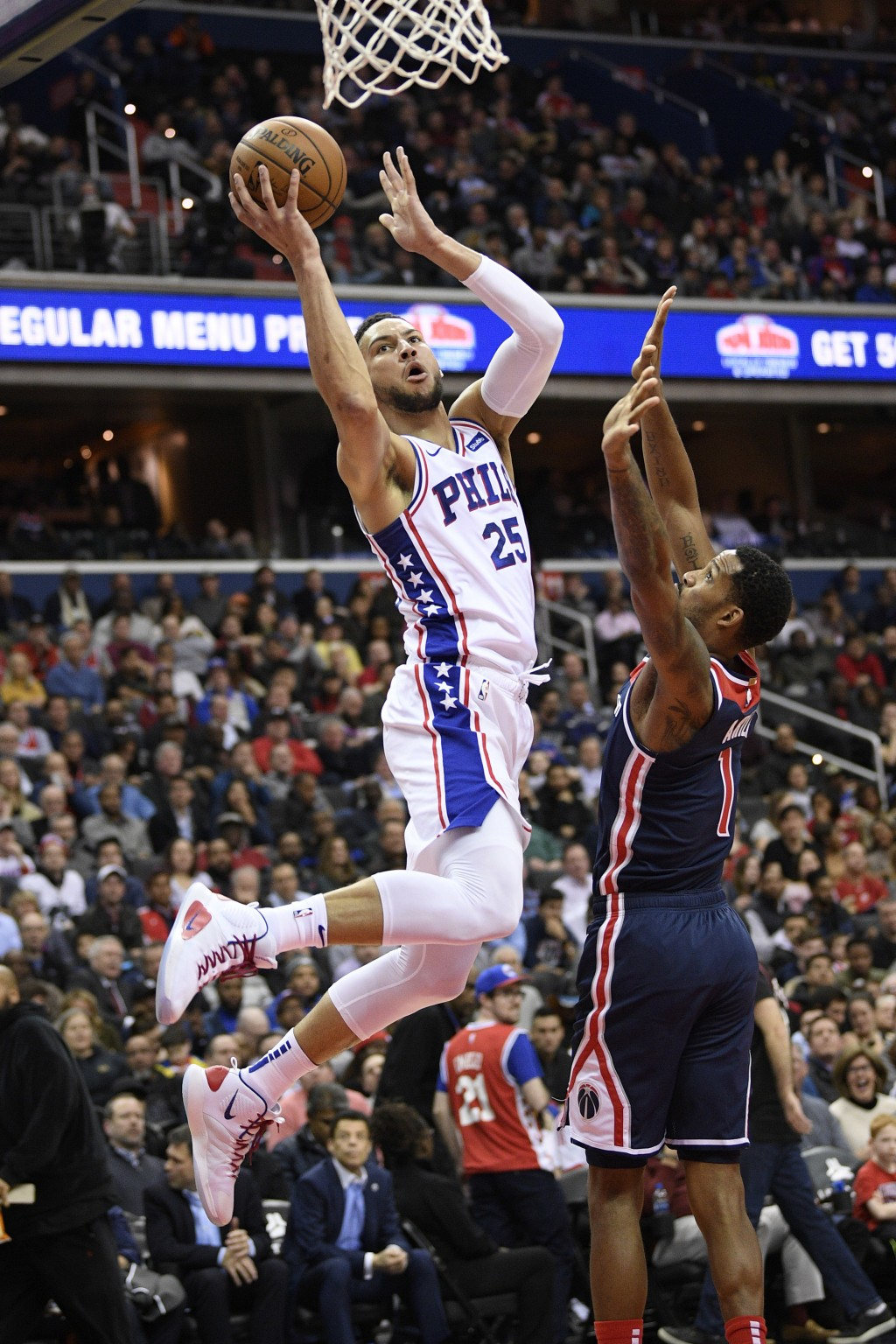 Philadelphia 76ers guard Ben Simmons (25) goes to the basket against Washington Wizards forward Trevor Ariza (1) during the first half of an NBA baske...
