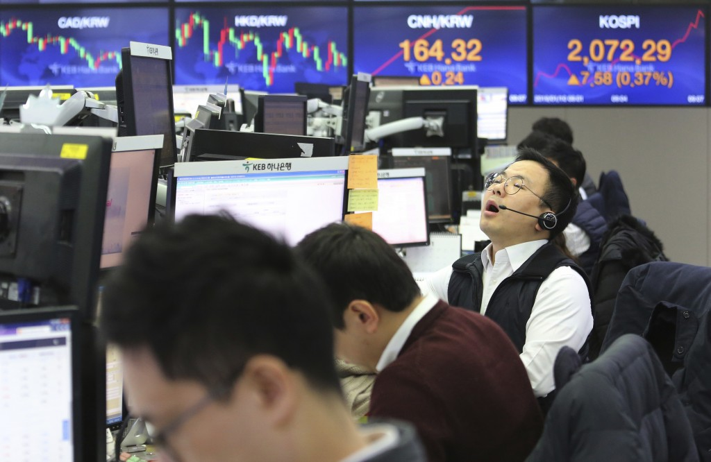 A currency trader shouts at the foreign exchange dealing room of the KEB Hana Bank headquarters in Seoul, South Korea, Thursday, Jan. 10, 2019. Asian ...