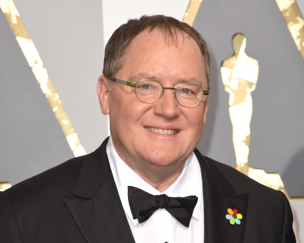 FILE - In this Feb. 28, 2016 file photo, Pixar co-founder and Walt Disney Animation chief John Lasseter arrives at the Oscars in Los Angeles. Lasseter...