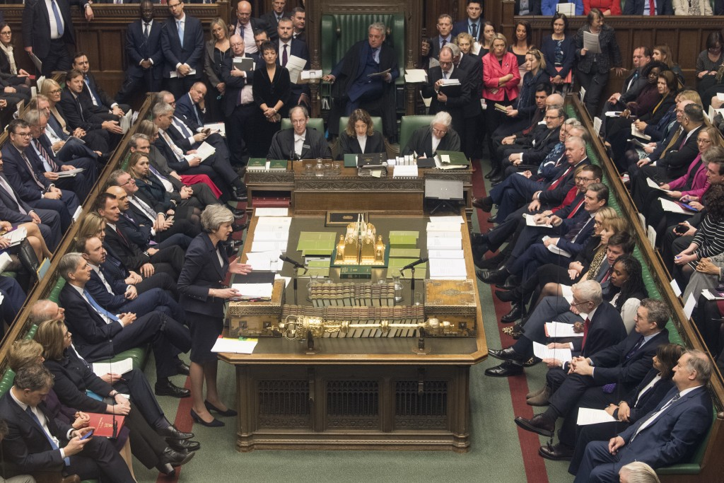 Britain's Prime Minister Theresa May speaks during Prime Minister's Questions in the House of Commons, London, Wednesday, Jan. 9, 2019.  The British g