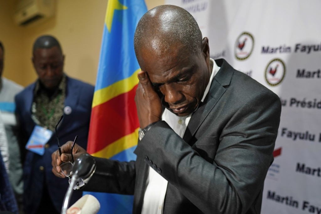 Opposition candidate Martin Fayulu wipes his face before speaking to the press at his headquarters in Kinshasa, Congo, Thursday Jan. 10, 2019. Fayulu,