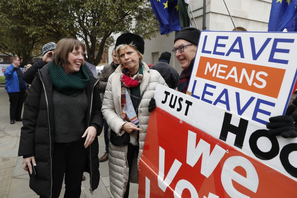 British conservative lawmaker Anna Soubry, centre, who campaigned to remain in the European Union during referendum debates, reacts with pro-Brexit pr...