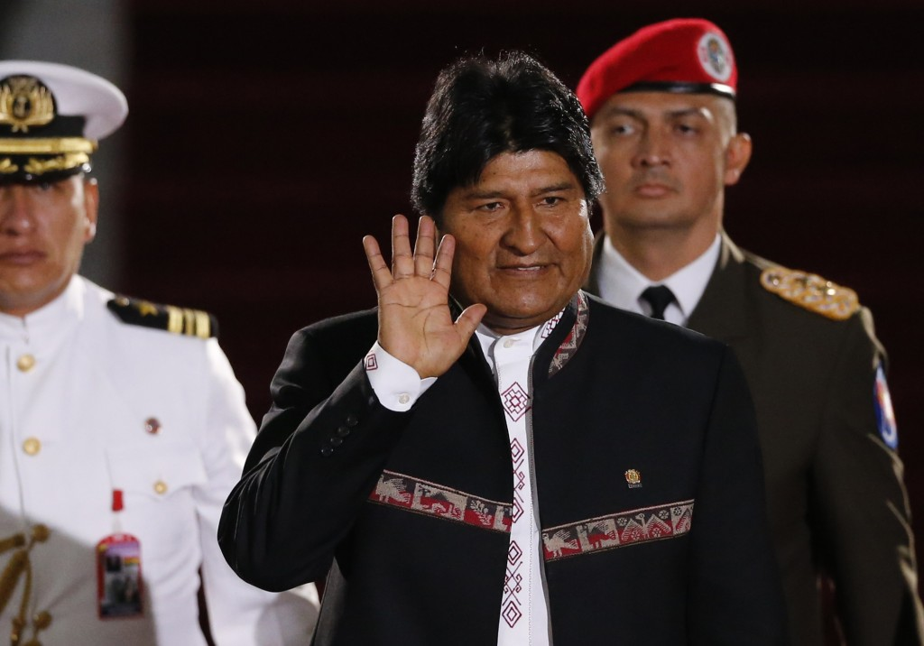 Bolivia's President Evo Morales waves as he arrives to the Supreme Court for the inauguration ceremony of President Nicolas Maduro in Caracas Venezue
